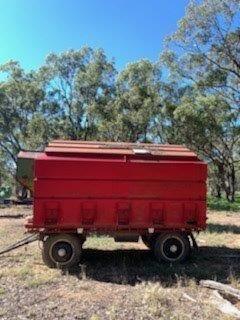 Side delivery bin