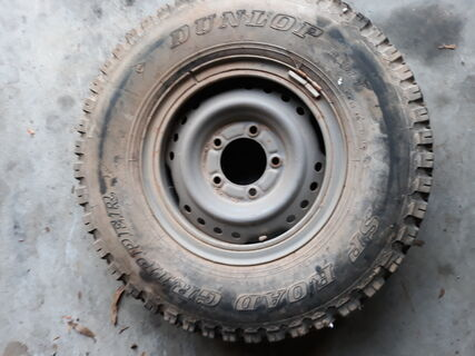 5 stud Landcruiser rim with 7.50R16 Dunlop tyre