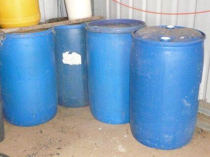 Qty blue poly storage drums