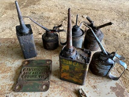 Assorted old oil cans