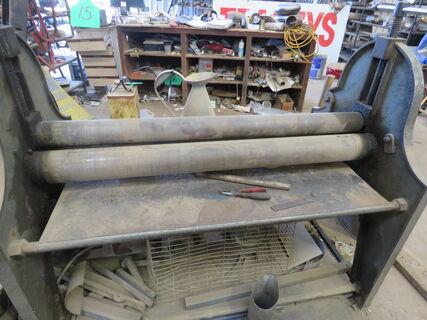 Metal plate roller