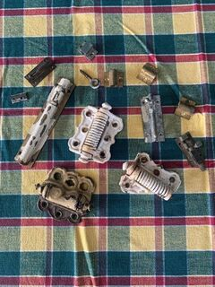 assorted hinges and sliding bolts