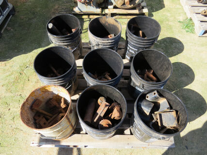 Pallet: 9x black buckets containing various heavy duty pins and row cropping brackets