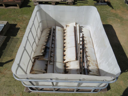 Shuttle containing Case IH header front wear plates