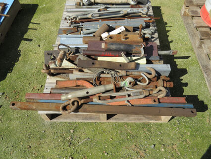Pallet containing threaded rod, third arm, various pins and turn buckles