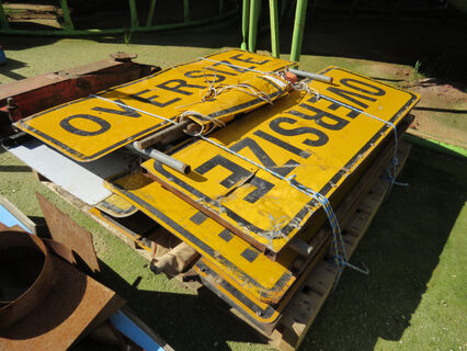 Pallet of 'Oversize' signs, 'Oversize Load Ahead' signs and safety flags
