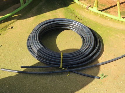 Roll of 19mm blue line poly pipe