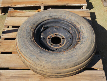 Pallet with a Uniroyal tyre 95L-15SL and rim