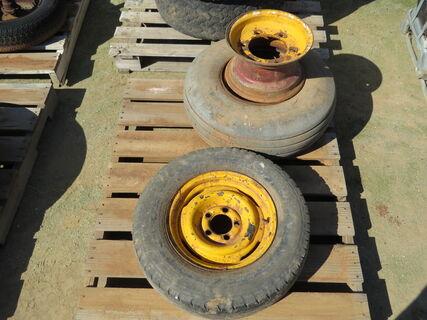 "Pallet with 2x 12"" rims suitable for a farm implement,"