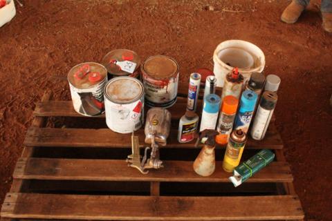 Assorted aerosol cans, spray paint gun