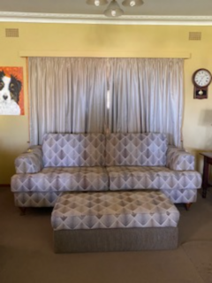 Four seater lounge with ottoman