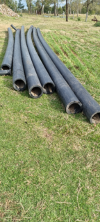 6 LENGTHS OF 250MM POLY PIPE APPROX. 10M LONG