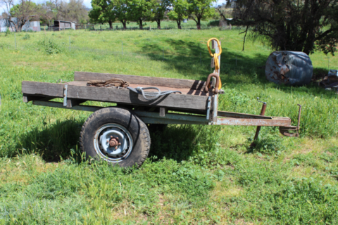 FARM TRAILER- METAL FRAME AND TRAY.