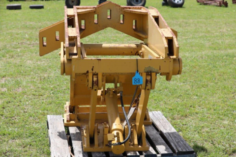 lift group attachment for a grader