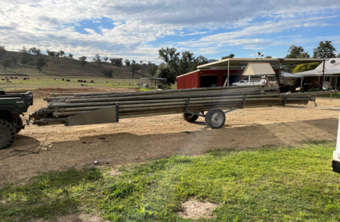 IRRIGATION PIPE TRAILER W/ PIPES